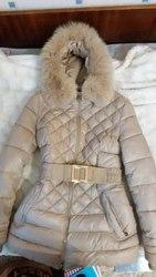 Продам женский зимний пуховик